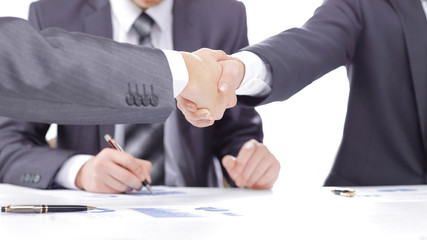 close up.handshake of financial partners after signing the contract