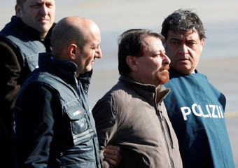 Former Italian leftist guerrilla Cesare Battisti arrives at Ciampino airport in Rome