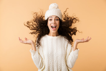 Happy young woman wearing winter clothes