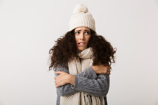 Upset young woman wearing winter scarf