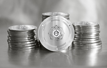 Exchange Union (XUC) digital crypto currency. Stack of silver coins. Cyber money.