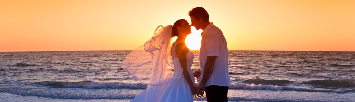 Bride and Groom Married Couple Kissing Sunset Beach Wedding