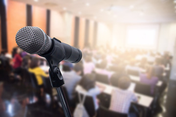 Microphone over the blurred business people forum Meeting or Conference Training Learning Coaching Room Concept, Blurred background.