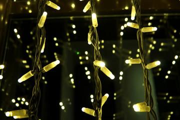 Luminous garlands in the dark.