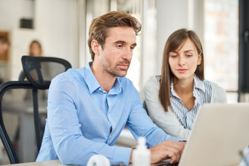 Two people in start up office, brainstorming about problems they encounter
