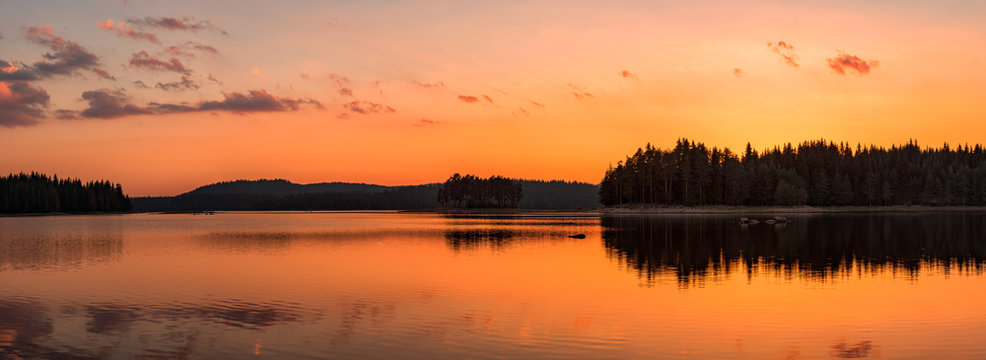 Golden lake sunset panorama / Panoramic view with golden lake sunset in Rhodope Mountains, Bulgaria