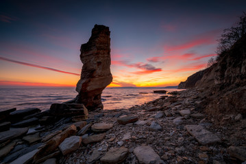 Lonely by the coast / Amazing sunset view of the rocky Black Sea coast, Bulgaria