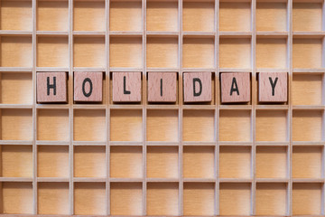 wood cubes with the word holiday