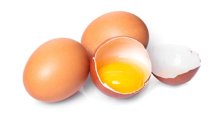 broken and whole chicken eggs