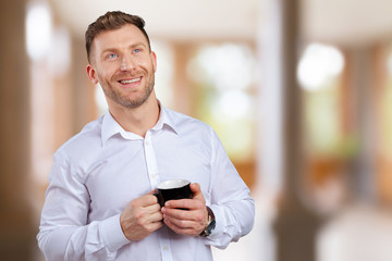 Handsome Smiling Businessman Holding  Cup