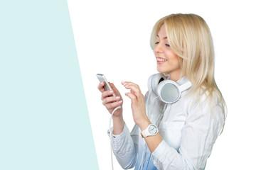 Happy young blonde woman listening to music