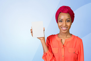 A beautiful woman with a perfect smile holds a business card