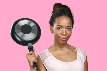 African american woman holding kitchen utensils