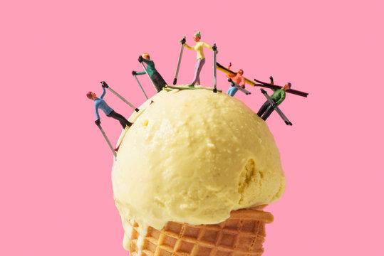 miniature skiers on an ice cream