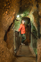 Young tourist woman explore ancient Kaymakli underground cave city