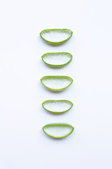 Aloe vera slices on white background.