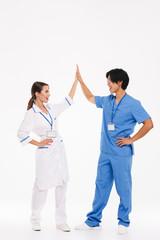 Happy doctors couple wearing uniform