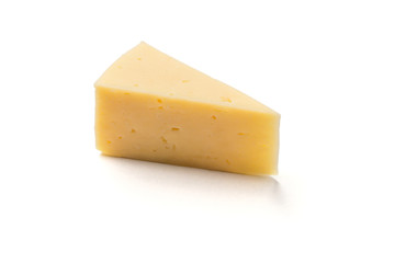 Piece of holland cheese over white