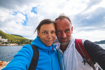 Happy couple taking selfie on the background of the bay Kas city