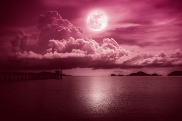 Poster Crimson Landscape of sky with full moon on seascape to night. Serenity nature.