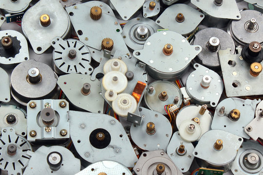 Pile of old stepper motors. Electronics industry e-waste background