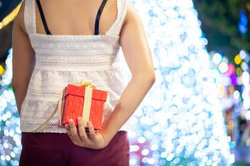 Women is holding a New year present. Gifts for men.Gift for a girl. - Image