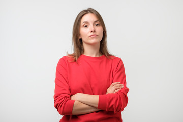 Young serious angry woman portrait on a white background