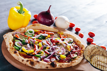Pizza with onion, grilled eggplant, pepper and zucchini
