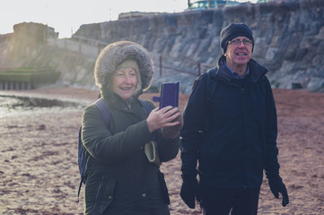 Senior couple on the beach in winter
