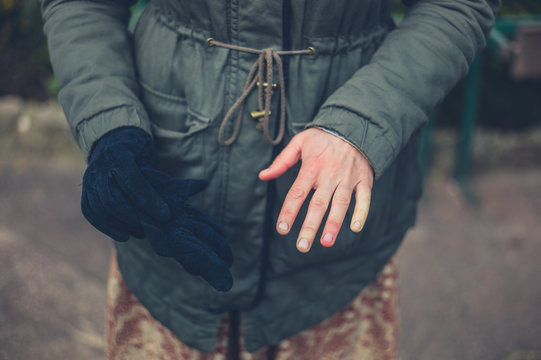 Woman with raynaud disease outdoors in winter