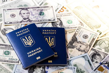 ukrainian passports on 100 dollar banknotes background