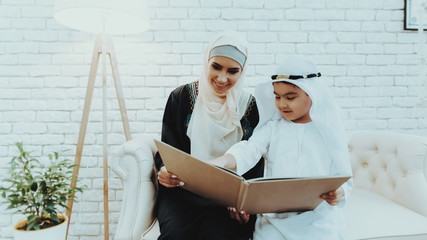 Arabic Mother with Son Wait for Doctor in Clinic