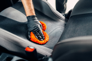 Chemical cleaning of car seats with spoonge