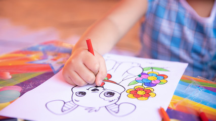 Hand holding a two-color pencil to draw and draw with a pencil set at the corner of the paper. Draw a blank picture for study and learn art.