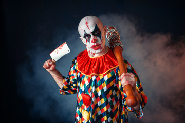 Bloody clown with meat cleaver and baseball bat
