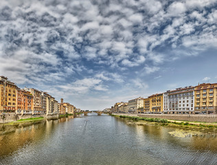Florence or Firenze city view on Arno river, landscape with reflection. Tuscany, Italy.