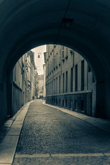 Parma, Italy. Street view through the arch in the Old town. (tone effect)