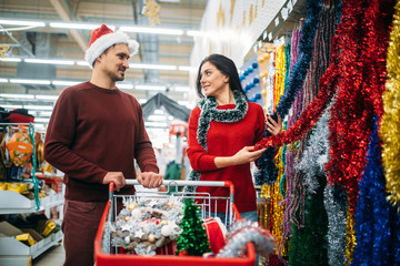 Young couple in department of holiday decorations