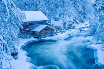 Blue winter river cabin