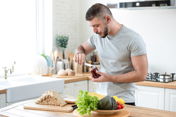 Male caucasian preparing breakfast in a kitchen