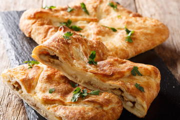 Khachapuri is a traditional Georgian dish of cheese-filled bread. The filling contains cheese sulguni, eggs
