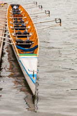 Close-up of an eight that is a rowing boat used in the sport of competitive rowing. It is designed for eight rowers, who propel the boat with sweep oars, and is steered by a coxswain, cox