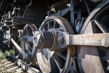 Old rusty wheels of the steam locomotive  and the elements of the drive