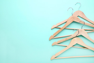 Wooden hangers on blue background