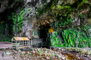 Smoo Cave entrance in Durness Scotland, a popular tourist attraction on the North Coast 500