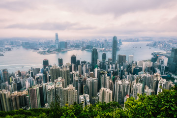 Modern City and Business with foggy weather from Victoria Peak, Hong Kong.