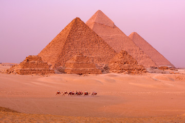 the great pyramids of giza in egypt with camel caravane