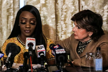 Faith Rodgers reacts as she reads a statement to reporters with attorney Gloria Allred during a news conference regarding allegations of sexual misconduct relating to musician R Kelly, in New York
