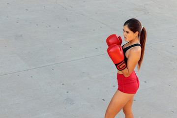 young woman boxing on the street