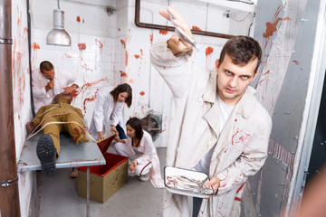 Guy frightening with medical instruments in quest room Wall mural